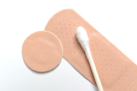 cotton swab: Adhesive bandage and cotton swab on white