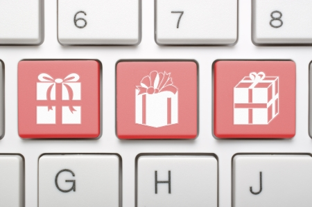 Red gift symbol on keyboard Stock Photo - 18002584