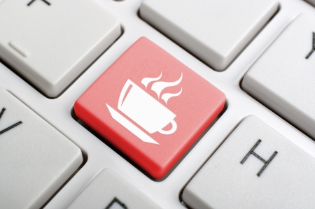 Red coffee symbol on keyboard photo