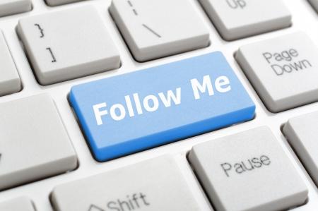 Blue follow me key on keyboard Stock Photo - 18084687