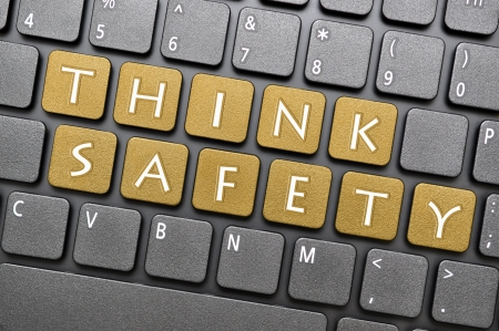 Golden think safety key on keyboard Stock Photo - 18084700