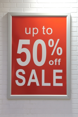 sell off: Fifty percent off sale sign on wall