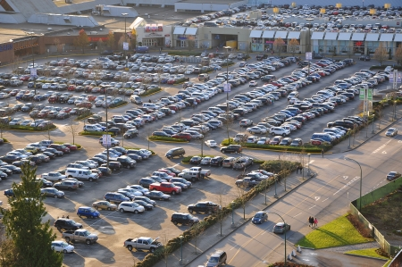 car retailer: Aerial view of shopping center car crowded parking lot.  In Coquitlam city of BC Canada. Editorial