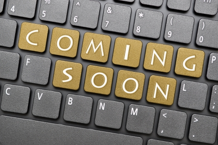 coming: Golden coming soon key on keyboard Stock Photo