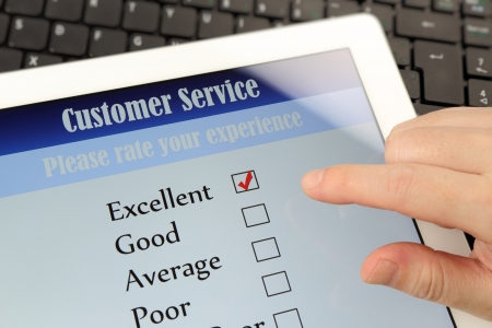email lists: Customer service on-line survey on screen Stock Photo