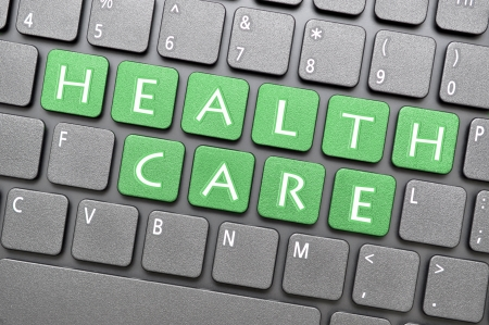 Green health care key on keyboard Stock Photo - 19925790