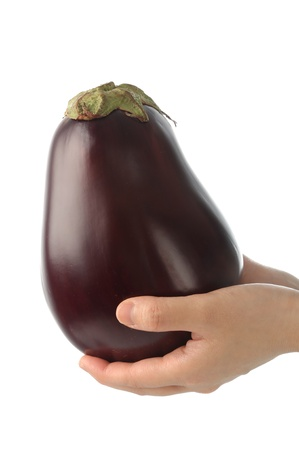 Woman holding a eggplant  photo