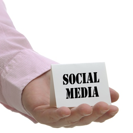 Businessman holding social media sign with white copy space  photo