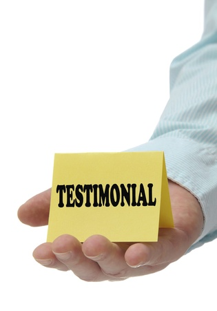 Businessman holding testimonial with white copy space