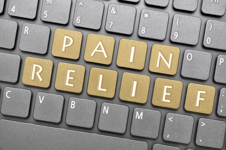 Golden pain relief key on keyboard Stock Photo - 20478605