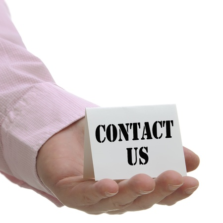 Businessman holding contact us sign with white copy space