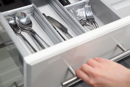 domestic kitchen: Opening drawer for Silver cutlery, focus on kitchenware