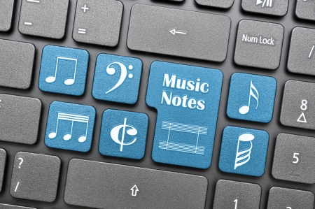 Blue music notes and symbols on keyboard photo