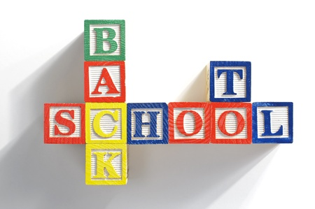 spelled: The phrase BACK TO SCHOOL spelled out in childrens alphabet wood blocks.