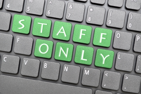 staff only: Green staff only key on keyboard Stock Photo