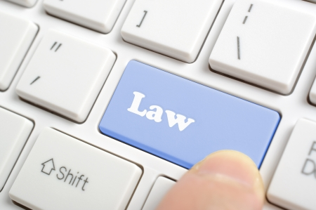 online privacy: Pressing blue law key on keyboard  Stock Photo