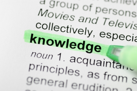 articles: Green marker on knowledge word on dictionary Stock Photo