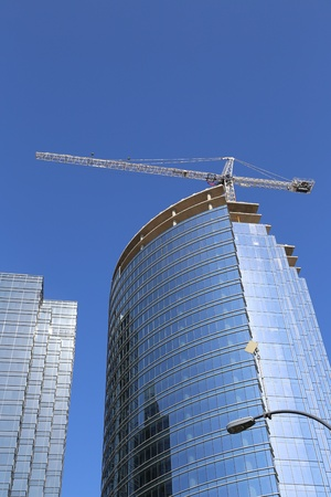 Business buildings with construction crane photo