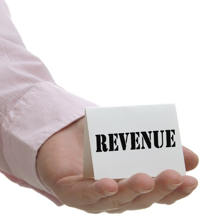 Business mand holding revenue sign on hand photo
