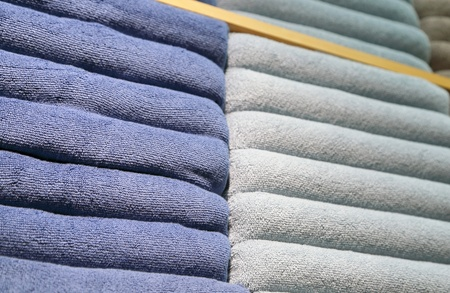 Shelves with multicolor bath towels  Stock Photo