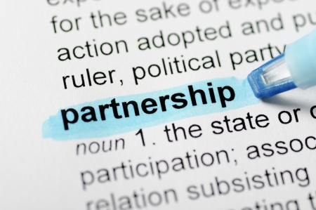 article writing: Blue marker on partnership word