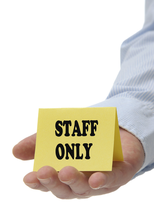 Business man holding staff only sign photo