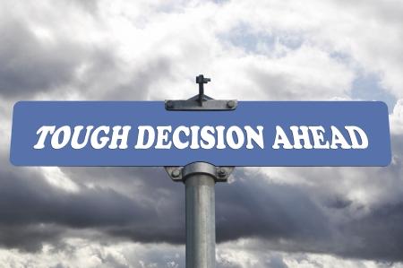 tough: Tough decision ahead road sign