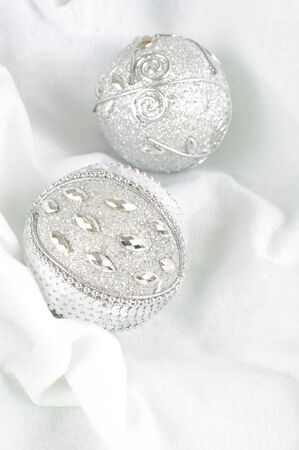 Christmas Baubles on snow background photo