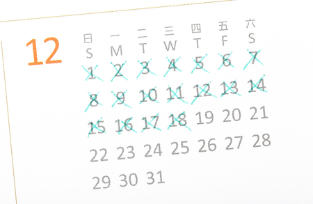 Close up of a white calendar page with some of the days crossed off with a green X