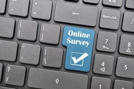Online survey key on keyboard Stock Photo