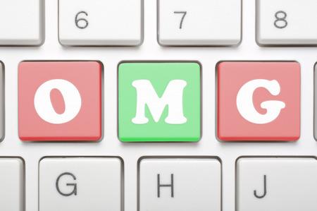 personal god: A computer keyboard with keys spelling OMG, Internet slang