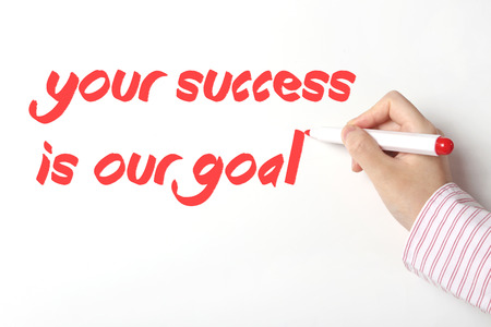 Writing your success is our goal word on whiteboard  photo