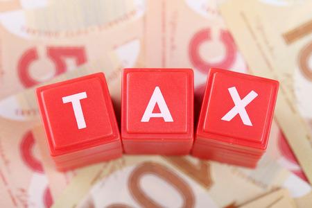 Tax word on money background Banco de Imagens - 27504965