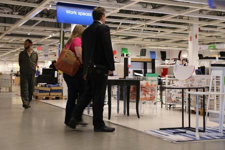 furniture store: Shopper inside furniture store Editorial