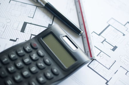 Architect with calculator and plan, pencil and ruler  photo