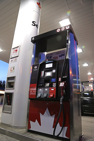 retained: One side of Petro Canada gas station on May 10, 2014. The company retained the Suncor Energy name for the merged corporation and its upstream operations.