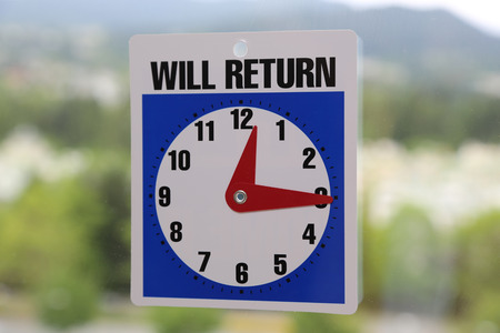 Will Return Sign with nature background photo