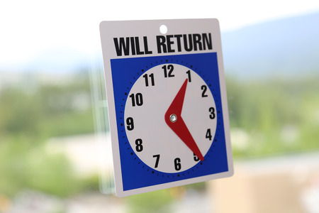 will return: will return sign with nature background  Stock Photo