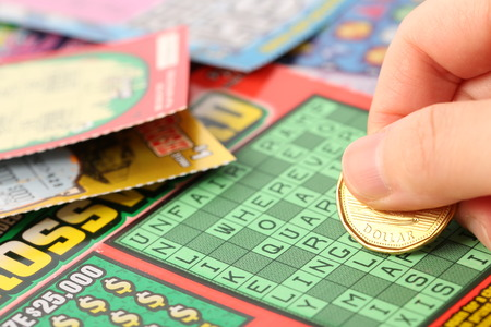 sanctioned: Coquitlam BC Canada - May 25, 2014 : Scratching lottery tickets. The British Columbia Lottery Corporation has provided government sanctioned lottery games in British Columbia since 1985.