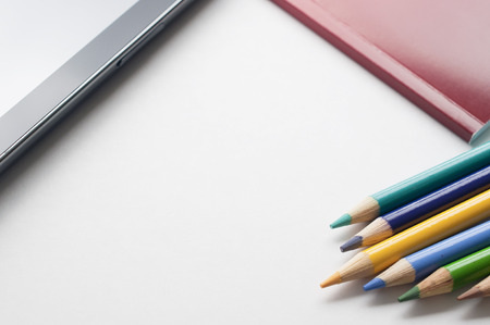 Tablet pc, notebook and pencil colors 版權商用圖片