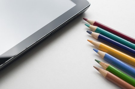 Tablet pc and colorful pen on white, abstract back to school concept