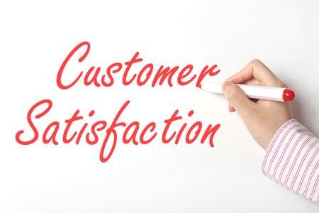 Writing customer satisfaction word on whiteboard  免版税图像