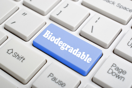 biodegradable: Blue biodegradable on keyboard Stock Photo
