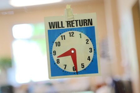 Will return sign with office background photo