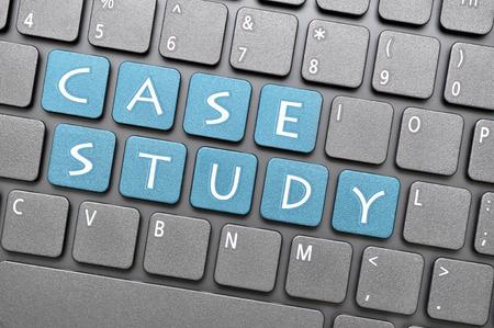 Blue case study key on keyboard Banco de Imagens