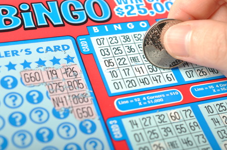 Scratching a lottery ticket. The British Columbia Lottery Corporation has provided government sanctioned lottery games in British Columbia since 1985. photo