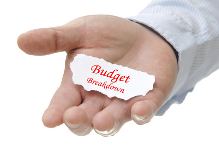 Business man holding budget breakdown note on hand
