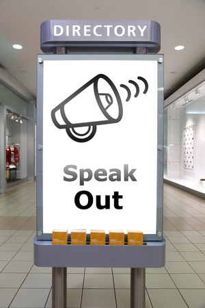 speak out: Speak out and direction sign inside shopping mall Stock Photo