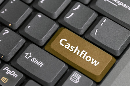 cashflow: Brown cashflow key on keyboard