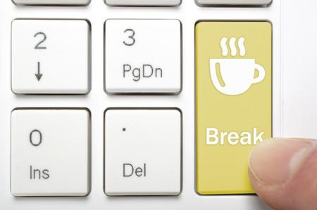 break: Pressing break and coffee key on keyboard Stock Photo
